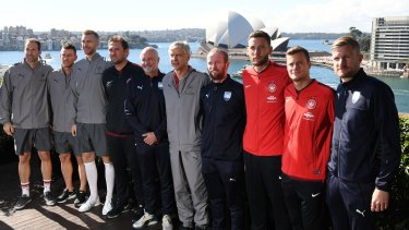 Engagement: Arsene Wenger poses with Petr Cech, Laurent Koscielny, Per Mertesacker, Graham Arnold and Sydney FC and Wanderers players.