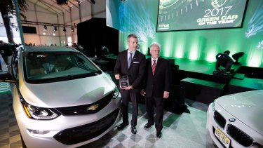 The 2017 Chevrolet Bolt EV is announced  winner of the Green Car of the Year Award in November. Major US car makers say Donald Trump's decision to pull out of the Paris Accord would not affect their pledges on climate change.