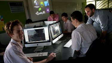 App developers Alex Benevento and William Egan  teach students how to develop code at their  old school Penleigh and Essendon Grammar where they have  started a code club.