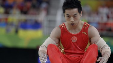 Heavy fall: gymnast You Hao tumbled from the parallel bars, and China did not win a single gymnastics gold medal in Rio