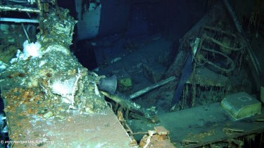 The wreckage of the USS Indianapolis, including the ship's bell at the bottom of the North Pacific Ocean as seen by a remotely operated camera.