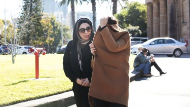 Mohammed Hamzy's wife, Meltem Yarar, (under the coat) and sister, leave the NSW Supreme Court.