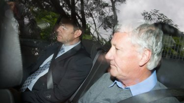 Bill Spedding is taken from his Bonny Hills home by detectives on Wednesday.