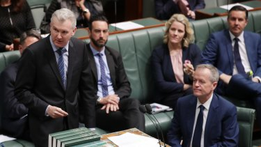 Manger of opposition business Tony Burke speaks during question time, flanked by Bill Shorten and the Labor frontbench.