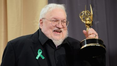 Full of stories ... <i>Game of Thrones</i> creator George RR Martin clutches his award from the recent Emmys.