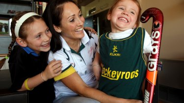 Dual Olympian Hope Munro with her daughters Ella and Olivia