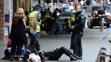 Police and paramedics with an injured pedestrian.