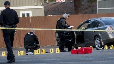 Coeur d'Alene police investigate the scene where pastor Tim Remington was shot.