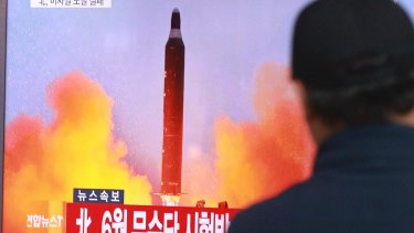 A man watches a TV news program showing a file image of a missile launch conducted by North Korea, at the Seoul Railway Station in Seoul.