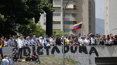 Anti-government demonstrators cross an overpass during a march against the Venezuelan government in Caracas on Wednesday.