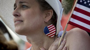 Things white people feel: rage. A Los Angeles woman listens to a speaker during a Tea Party Patriots rally.