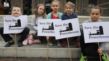 Children from the Webb and Carter families hold signs at the Save The Powerhouse Rally in 2015.