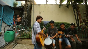 Titi Juwariyah, a mother of four from East Java, jams with her friends in Jakarta.