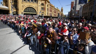 Crowds gather for the grand final day parade in 2014.