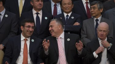 Happy news: Treasurer Joe Hockey (bottom centre) shares a joke with Turkey Deputy Prime Minister Cevdet Yilmaz (left) at the Ankara G20 summit. RBA governor Glenn Stevens (right) has a few things to ponder.
