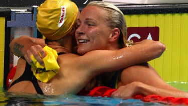 Sarah Sjostrom of Sweden is congratulated by Emma McKeon.