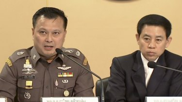 Thai Police Major Genenal Kornchai Klaiklung, left, the head of the anti-human trafficking wing of the police, and government spokesman Sansern Kaewkamnerd, right, speak at a news conference in Bangkok earlier this week.
