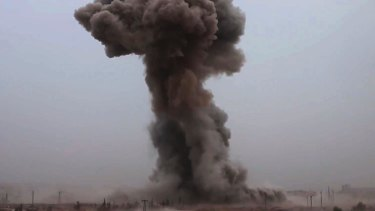 Smoke rises from an explosive vehicle bomb south-west of Aleppo, Syria, in 2016.