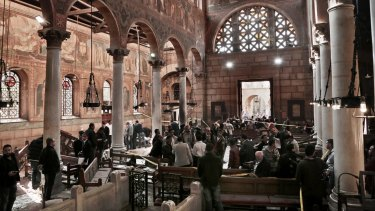 Inside the church of St Peter and St Paul in Abbasiya, central Cairo, following the bombing on Sunday.