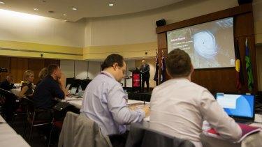 Queensland Treasurer Curtis Pitt briefing journalists in the budget lockup.