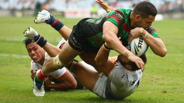 Too strong: Greg Inglis crosses for the Rabbitohs in round 3.