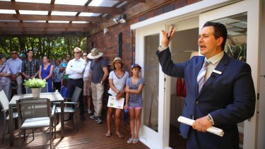 Ultra-low interest rates would have an extreme impact on house prices, QIC has warned.