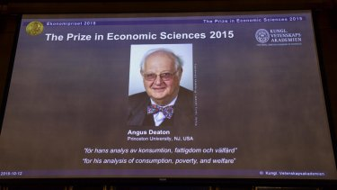 Professor Angus Deaton appears on screen as the winner of the Nobel Prize for Economics at the Royal Swedish Academy of Science, in Stockholm on Monday.