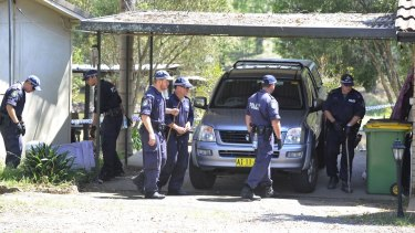 Police conduct a line search of the property where Inspector Bryson Anderson was fatally stabbed in Oakville, north-west of Sydney, in December 2012.