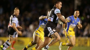 Front-foot ball: Andrew Fifita charges forward for the Sharks.