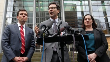 Washington Attorney-General Bob Ferguson, centre, with Solicitor General Noah Purcell, left, and Civil Rights Unit Chief Colleen Melody in Seattle, says the ban discriminates against Muslims.