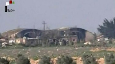 Burnt and damaged hangars after they were attacked by US Tomahawk missiles on Friday.
