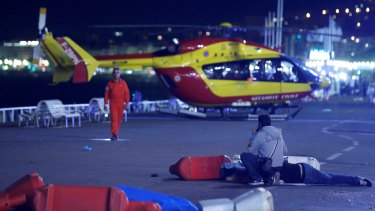 A helicopter prepares to evacuate the victims.