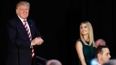 Ivanka Trump smiles at her father, Republican presidential candidate Donald Trump.