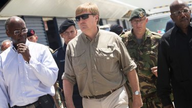 Dutch King Willem-Alexander, centre, visits St Maarte in the Dutch Caribbean after the passing of Hurricane Irma in September.