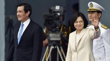 New President Tsai Ing-wen, right, waves beside former President Ma Ying-jeou on Friday.
