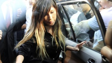 Singaporean pop music singer Ho Yeow Sun leaving court during the case against her husband. She was not charged but her husband was found guilty of diverting millions to support her career.