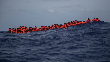 Sub-Saharan migrants wait to be rescued by aid workers of Spanish NGO Proactiva Open Arms in the Mediterranean Sea, about 24 kilometres north of Sabratha, Libya.