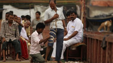 Patients are bound before being cut at a blood-letting clinic in New Delhi, India.