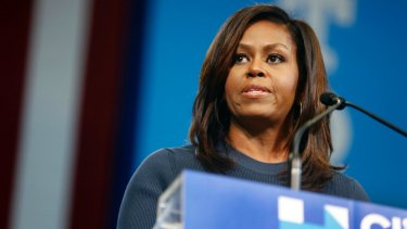Support: Michelle Obama delivers a blistering attack on Donald Trump.