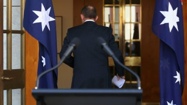Tony Abbott gave no indication of whether he would continue on the backbench.