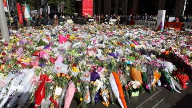 Sea of flowers: The memorial to the victims of the Lindt Chocolat Cafe siege continued to expand in Martin Place on Wednesday.