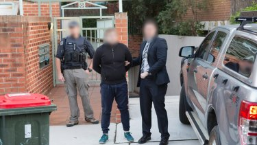 AFP handout photo showing the arrest of Adam Cranston outside his Bondi home.