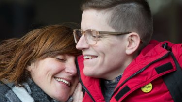 Roz Ward is hugged by a supporter on her return to work at La Trobe University in June.