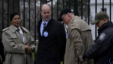 Bill McKibben (black cap) was among activists arrested outside the White House in 2013 protesting against the proposed expansion of the Keystone oil pipeline. Two years later, the expansion was canned.