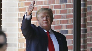 Thumbs-up: Trump leaves the residence of the Indiana Governor on Wednesday.
