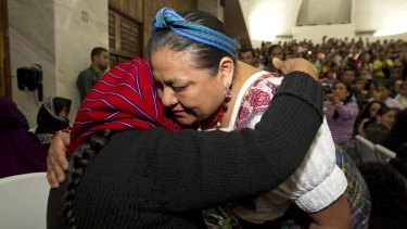 Rigoberta Menchu Tum, Nobel Laureate, right, embraces a victim of sexual violence moments after a judge read the guilty verdict for a former military officer and former paramilitary fighter for the sexual abuse of indigenous women.