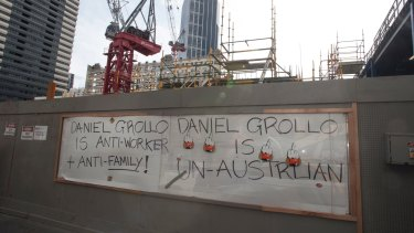 Striking CFMEU workers at the Grocon Emporium building site in Melbourne make their feelings known in September, 2012.