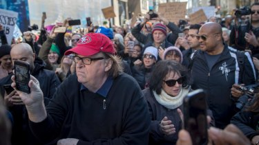Filmmaker Michael Moore joins the demonstrators during a protest against the election of Donald Trump on Fifth Avenue near Trump Tower.