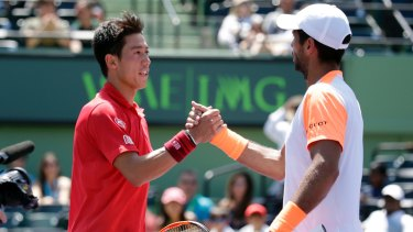 Respect: Kei Nishikori, left, and Fernando Verdasco shake hands after their marathon match.