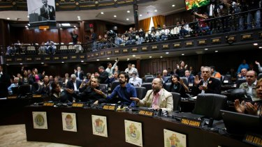 """Opposition lawmakers shout, """"Fraud, fraud"""" during a session of the Venezuelan National Assembly after learning that results of Venezuela's election on Sunday may be off by at least 1 million votes."""